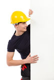Repairman peeking at the banner Royalty Free Stock Images