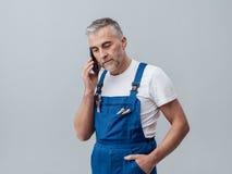 Repairman on the phone Stock Photos
