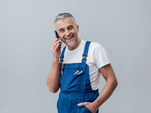 Repairman on the phone Royalty Free Stock Images