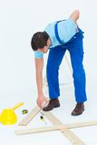 Repairman picking up screwdriver while suffering from backache Royalty Free Stock Images