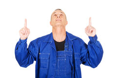 Repairman pointing up with both hands Royalty Free Stock Images