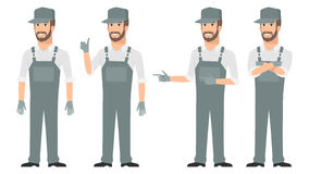 Repairman pointing in various poses Royalty Free Stock Photos
