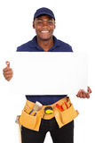 Repairman presenting white board. Portrait of young afro american repairman presenting white board Stock Photos