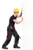 Repairman pushing the wall Stock Photography