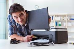 The repairman repairing broken color printer royalty free stock photography
