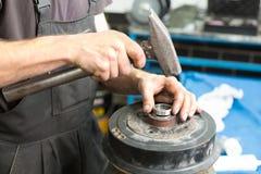 Repairman repairing a car part Stock Images
