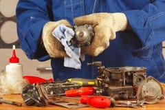 Repairman repairing parts car engine in the workshop Stock Photo