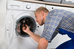 Repairman Repairing Washer Stock Photos