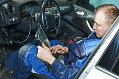 Repairman servicing auto car Stock Images