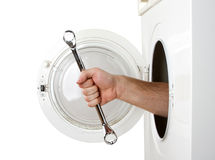 Repairman servicing washing machine stock photography