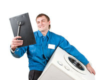 Repairman servicing washing machine Royalty Free Stock Photos