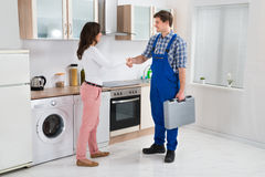 Repairman Shaking Hands With Woman Royalty Free Stock Images