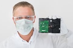 Repairman Showing Harddisk Royalty Free Stock Images
