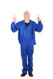 Repairman som pekar upp med båda händer Arkivfoton