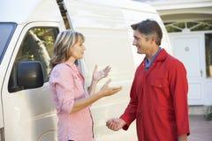 Repairman Talking To Female Customer Royalty Free Stock Photos