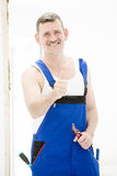 Repairman with thumbs up Royalty Free Stock Photo