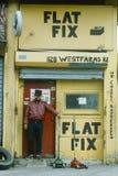 A repairman at a tire shop, Stock Image