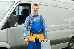 Repairman With Tools And Toolbox In Front Of Van Royalty Free Stock Photography