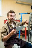 Repairman with touchpad royalty free stock image