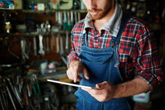 Repairman with touchpad Royalty Free Stock Images
