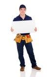 Repairman trzyma białą deskę obraz royalty free