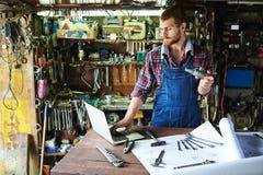 Repairman typing royalty free stock images