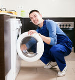 Repairman in uniform Stock Images
