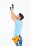 Repairman using hand drill Stock Photos