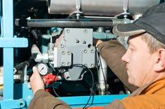 Repairman using manometer. Serviceman repairman measuring the pressure with manometer Royalty Free Stock Photos