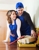 Repairman and woman dating Stock Photo