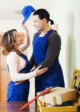 Repairman and woman having romance Stock Photos