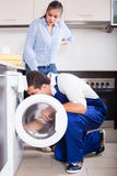 Repairman and woman near washing machine Royalty Free Stock Photography