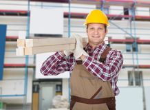 Repairman With Wooden Plank Stock Photography