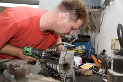 Repairman by the work Stock Images