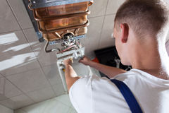 Repairman during work in bathroom Royalty Free Stock Images