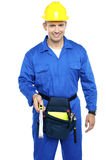 Repairman at work holding measuring tape Royalty Free Stock Images