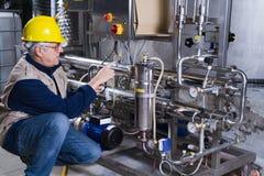 Repairman at work. Repairman at maintenance work in a industry Stock Photo