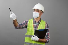 Free Repairman Worker With Clipboard Pointing To Somewhere Royalty Free Stock Photography - 183579717