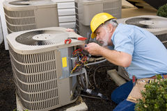 Repairman Working On Air Conditioner Stock Photography