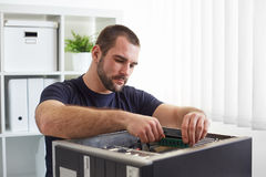 Repairman working with computer Royalty Free Stock Photography