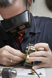 Repairman Working On An Old Clock Royalty Free Stock Photography