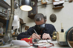 Repairman Working On An Old Clock Royalty Free Stock Photos