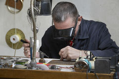 Repairman Working On An Old Clock Stock Image