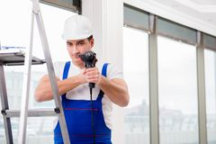 The repairman working with power drill in workshop Royalty Free Stock Photography
