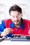 Repairman working in technical support fixing computer laptop tr Royalty Free Stock Photography