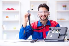 Repairman working in technical support fixing computer laptop tr Royalty Free Stock Image