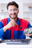 Repairman working in technical support fixing computer laptop tr Stock Image