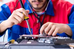 Repairman working in technical support fixing computer laptop tr Stock Photo
