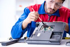 Repairman working in technical support fixing computer laptop tr Royalty Free Stock Images