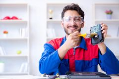 Repairman working in technical support fixing computer laptop tr Stock Photography